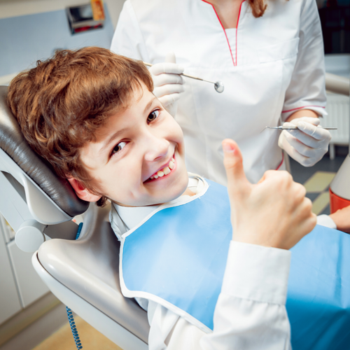 Child Sitting on Dentist Chair